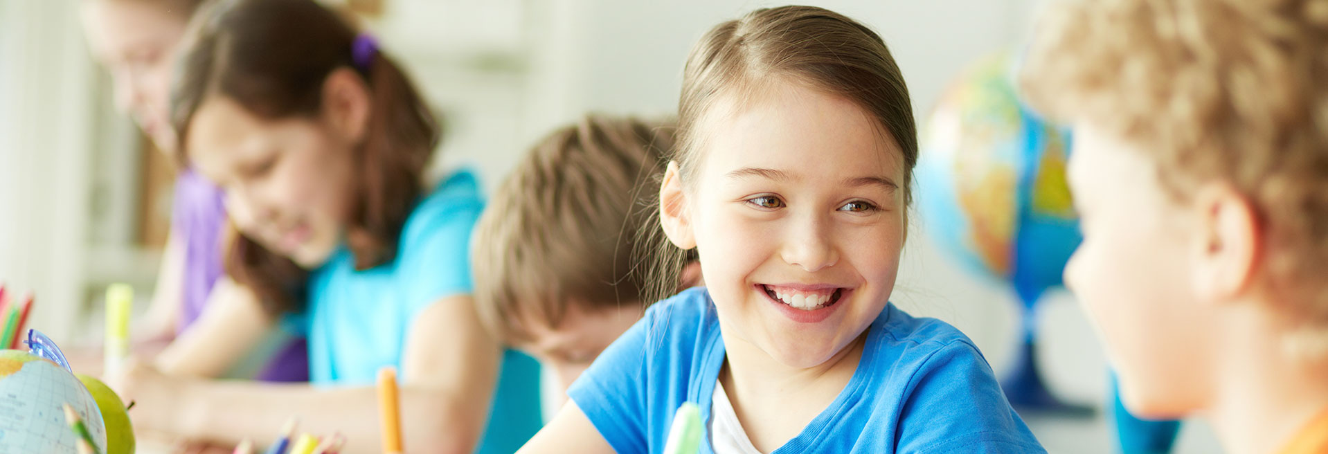 Girl smiling at classmate
